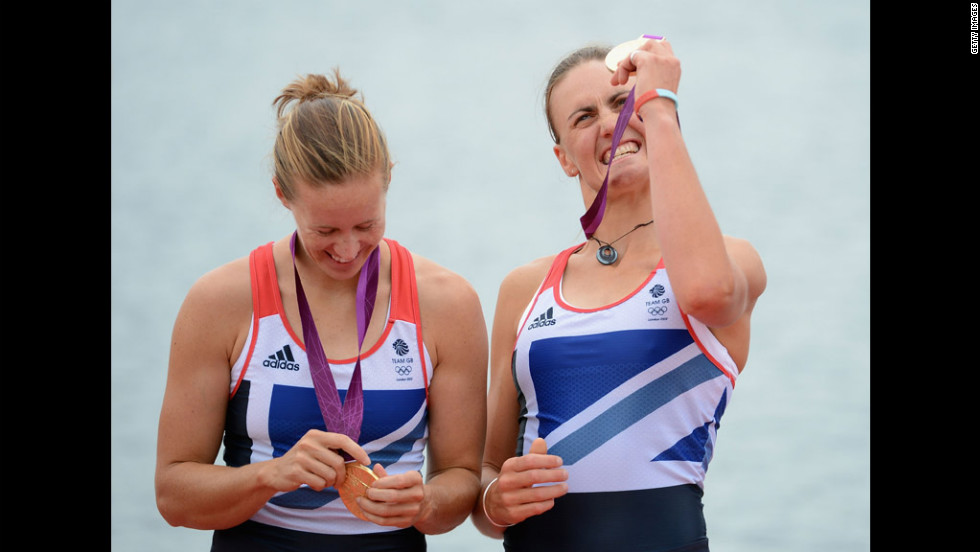 Rowers Helen Glover, left, and Heather Stanning of Great Britain celebrate with their gold medals during the medal ceremony.