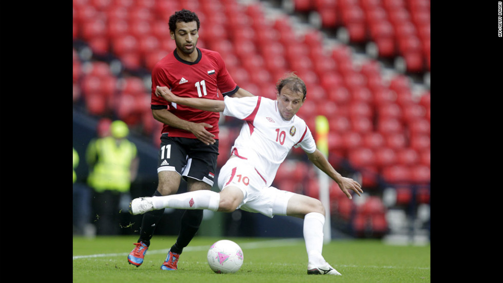 Egypt's Mohamed Salah, left, vies with Belarus' Renan Bardini Bressan during a men's soccer match.