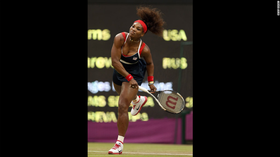 Serena Williams of the United States serves to Vera Zvonareva of Russia during the third round of women's singles tennis.
