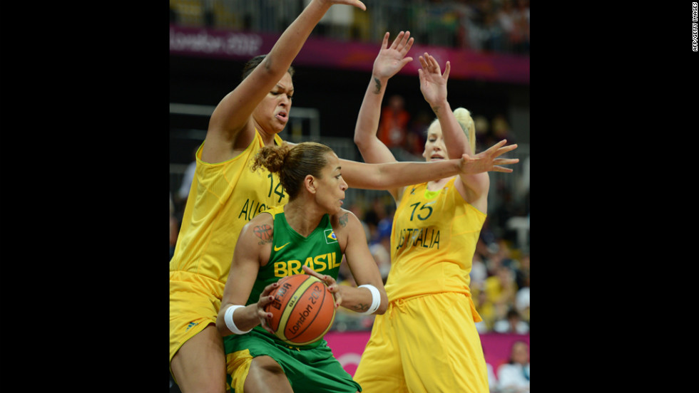 Brazil's Erika Souza, center, vies with Australia's Lauren Jackson, right, and Elizabeth Cambage during a  women's preliminary basketball match.
