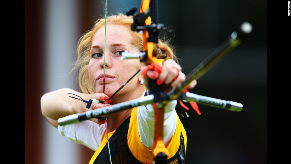 Lidiia Sichenikova of Ukraine competes in the women's individual archery 1/32 eliminations match against Ekaterina Timofeyeva of Belarus.