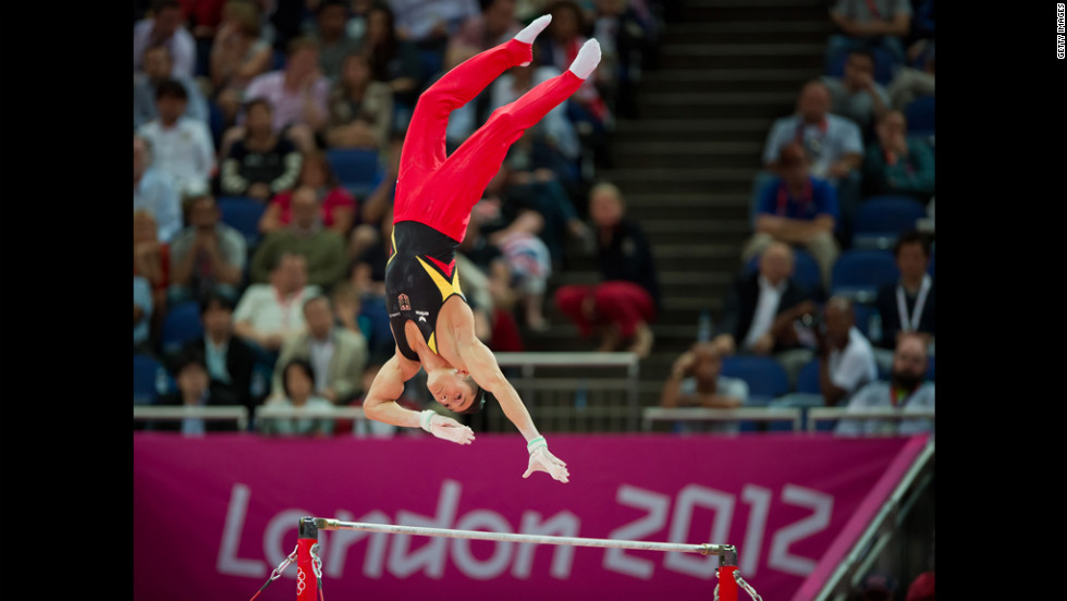 Germany's Marcel Nguyen reaches for the high bar during his silver medal performance in men's individual all-around gymnastics.