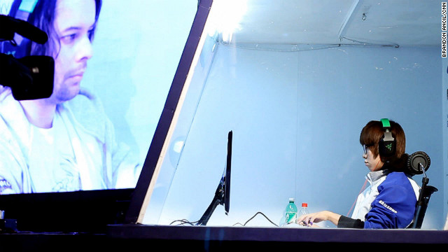 "Pro-gamer ""MarineKing"" plays a game of ""Starcraft II"" on the main stage of the World Cyber Games."