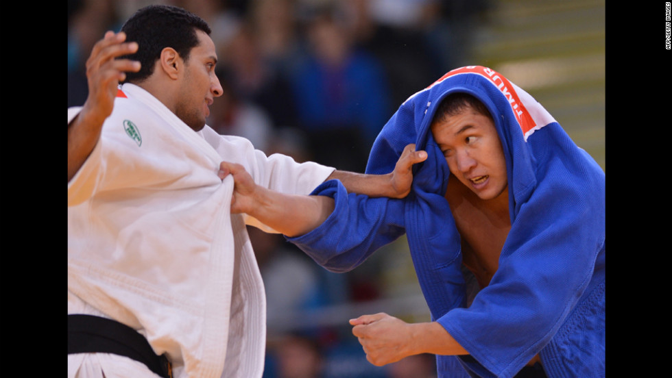 Egypt's Hesham Mesbah, left, competes with Kazakhstan's Timur Bolat during their men's 90-kilogram Judo contest Wednesday.