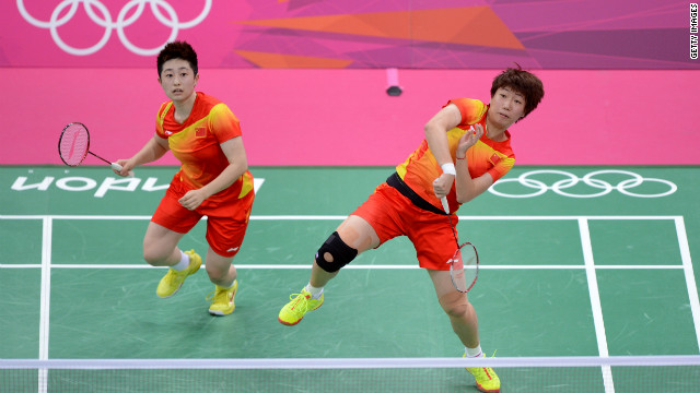 LONDON, ENGLAND - JULY 28:  Yang Yu (L) and Xiaoli Wang (R) of China returns a shot against Michele Li and Alex Bruce of Canada during their Women's Doubles Badminton on Day 1 of the London 2012 Olympic Games at Wembley Arena on July 28, 2012 in London, England.  (Photo by Michael Regan/Getty Images)