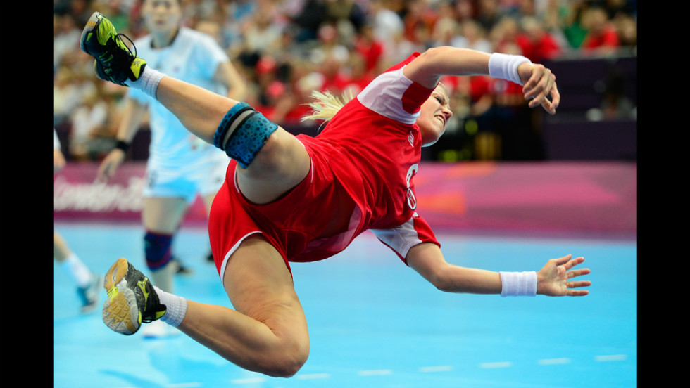 Norway's Heidi Loke jumps as she shoots during the women's preliminaries handball match against South Korea on Wednesday.