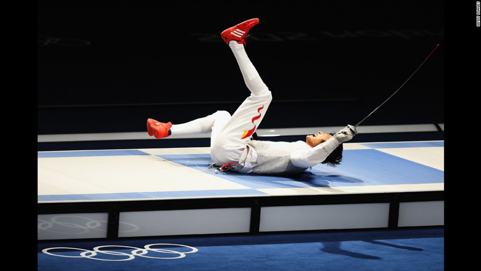 Sheng Lei of China celebrates winning the men's foil individual gold medal bout against Alaaeldin Abouelkassem of Egypt.