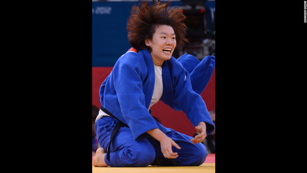 Korea's Hwang Ye-Sul celebrates after defeating Slovenia's Rasa Sraka in women's 70-kilogram judo on Wednesday.