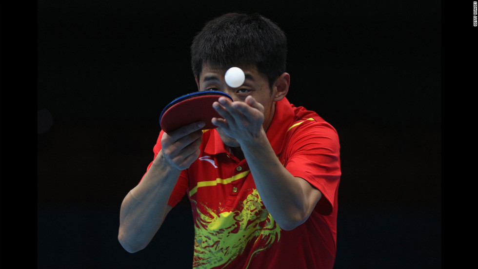 Zhang Jike of China serves during the men's singles table tennis quarter-final match against Tianyi Jiang of Hong Kong on Wednesday.