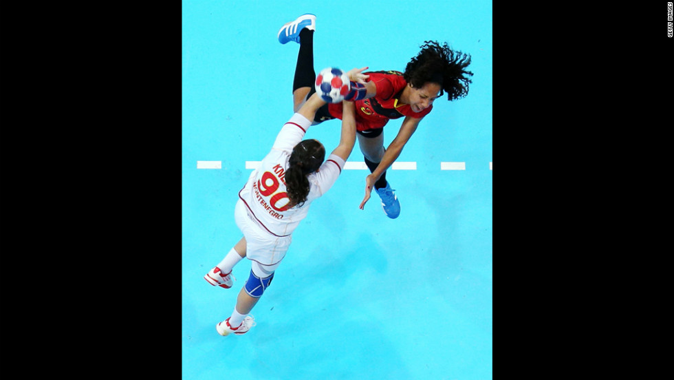 Carolina Morais of Angola throws over Milena Knezevic of Montenegro in a women's preliminary handball match Wednesday.