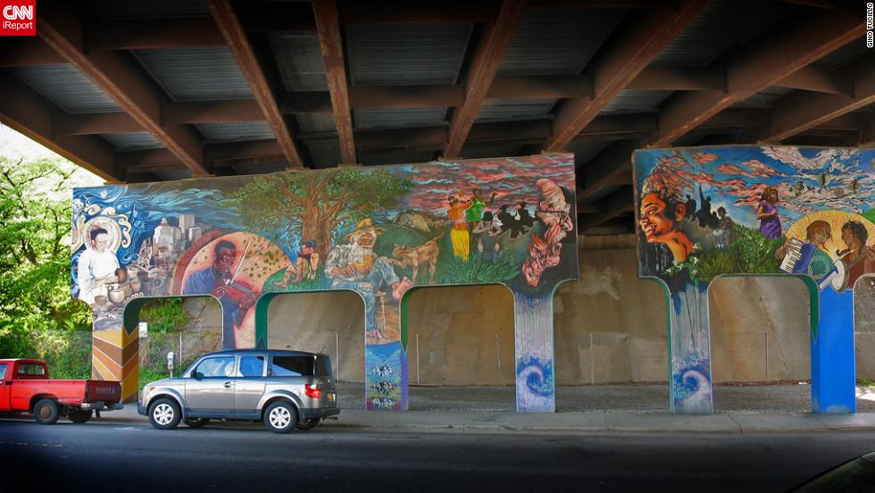 "Street art spray painted under a bridge in <a href=""http://ireport.cnn.com/docs/DOC-795655"">Asheville, North Carolina</a>."