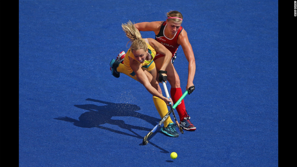 Katelyn Falgowski, right, of the United States goes after the ball with Fiona Boyce of Australia during a women's field hockey preliminary match.