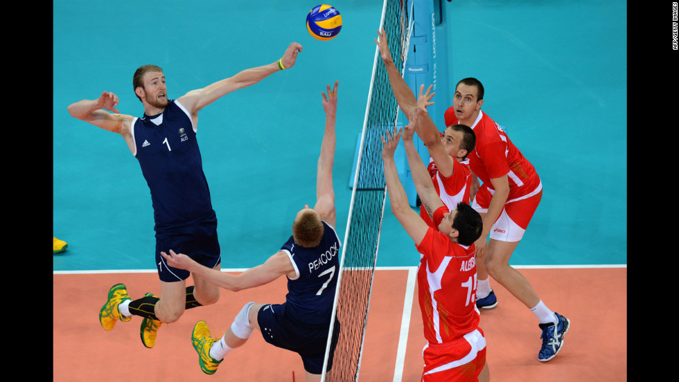 Australia's Aidan Zingel, left, spikes next to teammate Harrison Peacock during a men's preliminary volleyball match against Bulgaria.