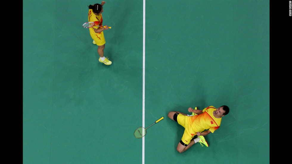 Jin Ma, left, and Chen Xu of China celebrate their victory over Indonesian foes in a mixed-doubles badminton semifinal.