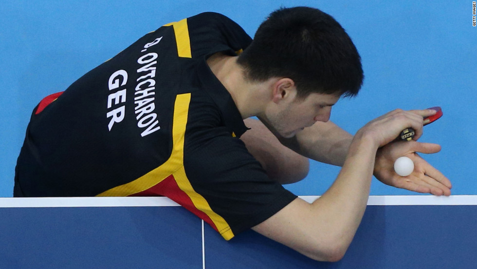 Germany's Dimitrij Ovtcharov serves during a men's singles table-tennis bronze medal match against Chih-Yuan Chuang of Taiwan.