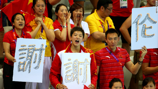 Chinese fans cheer on their athletes at the Aquatics Center at the London Olympic Games, August 1, 2012.
