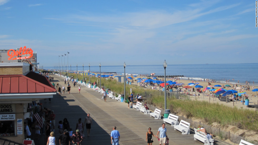 The old-fashioned boardwalk at Rehoboth Beach offers strolling, snacks, carnival rides and games.
