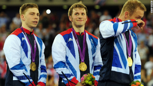 Chris Hoy wipes away a tear as he shares the podium with teammates Philip Hindes and Jason Kenny.