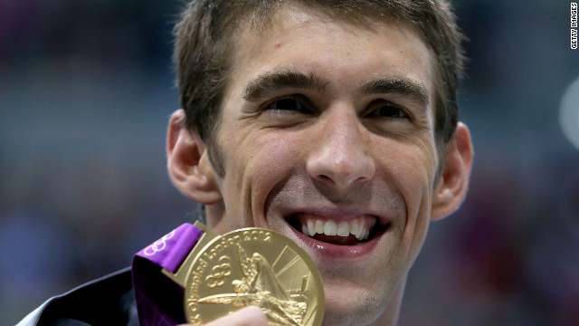 Michael Phelps shows off his gold medal from the 200m Individual Medley at the 2012 London Olympics.