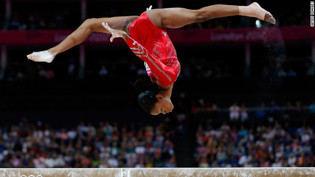 The USA's Gabby Douglas somersaults on the high beam.