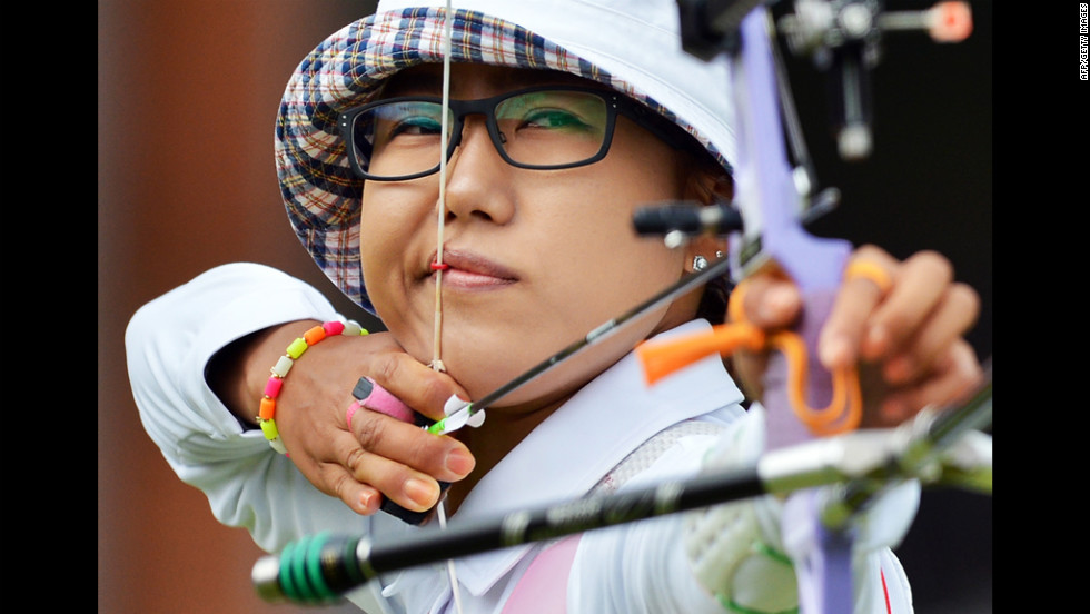 South Korea's Lee Sung-Jin competes in the women's individual 1/8 archery elimination match at Lord's Cricket Ground.