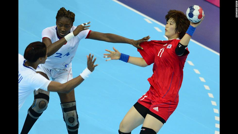 France's Mariama Signate, left, vies with South Korea's Ryu Eun Hee during a women's preliminary handball match.