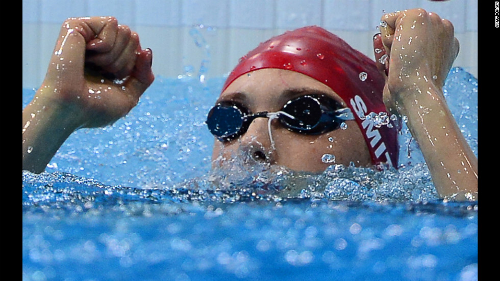 Britain's Amy Smith reacts after competing in the women's 50-meter freestyle swim-off.