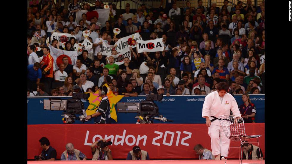 Japan's Mika Sugimoto salutes the mat after winning the women's over 78-kilogram judo quarterfinal.