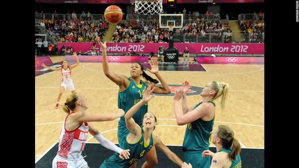 Russian center Irina Osipova, left, faces off with Australian center Elizabeth Cambage, center, during a women's preliminary round basketball match.