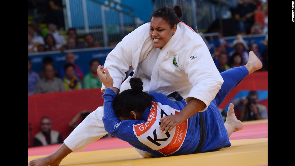 Brazil's Maria Suelen Altheman, in white, competes with Kazakhstan's Gulzhan Issanova during the women's over 78-kilogram judo repechage match.