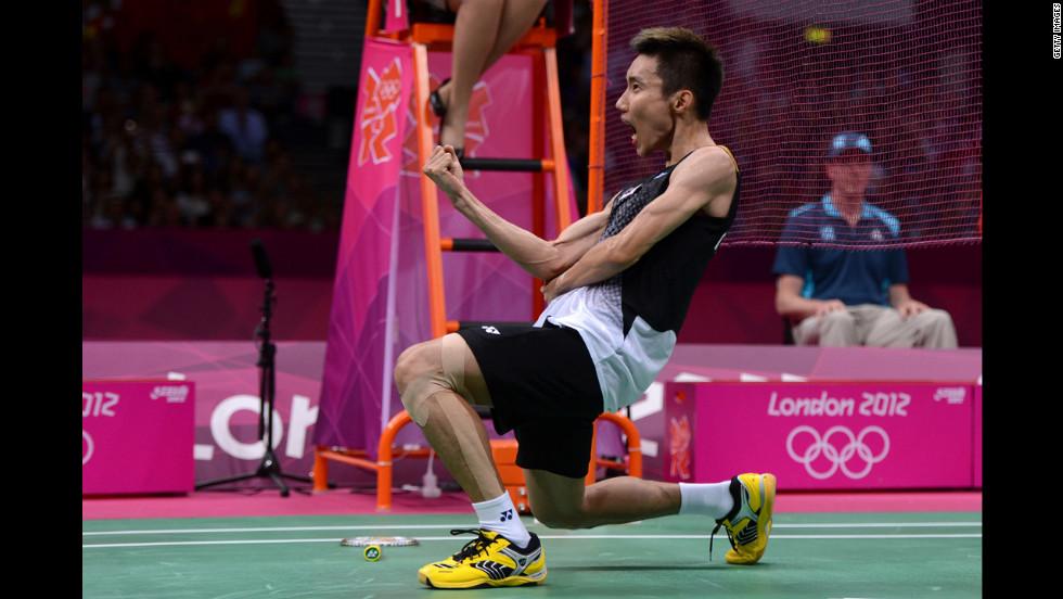 Malaysia's Chong Wei Lee celebrates winning the men's singles badminton semifinal against Long Chen of China.