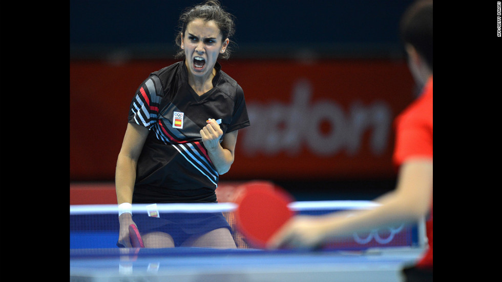Sara Ramirez of Spain gets a point against China's Guo Yue during a table-tennis match.