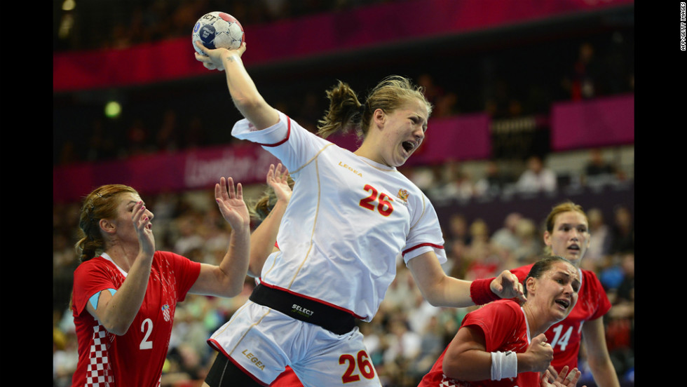 Montenegro pivot Suzana Lazovic jumps to shoot during a women's preliminary handball match against Croatia.