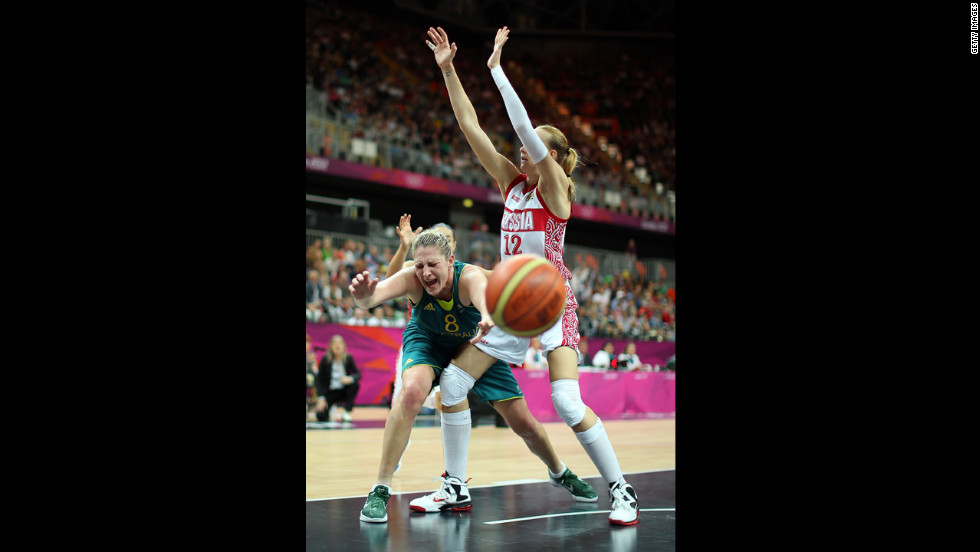 Australia's Suzy Batkovic, center, reacts after losing the ball under pressure from Russia's Irina Osipova during a women's basketball preliminary round.