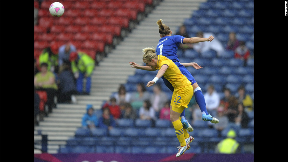Corine Franco of France and Marie Hammarstrom of Sweden battle for the ball during a women's football quarterfinal match.
