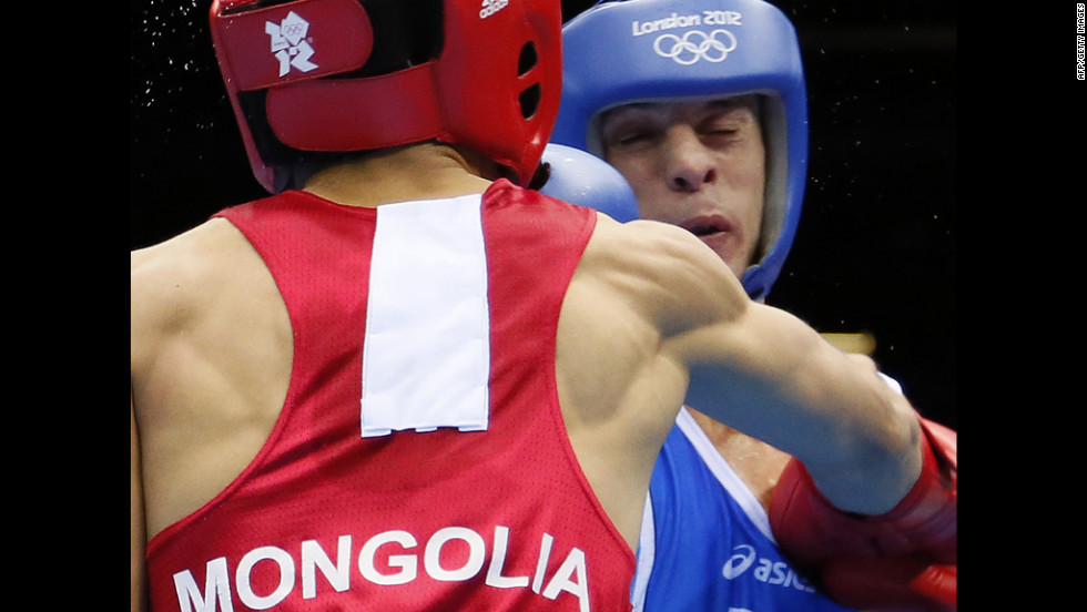 Italy's Vincenzo Picardi, right, is on the receiving end against Tugstsogt Nyambayar of Mongolia during a flyweight match.