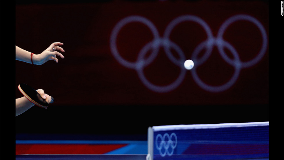 Tianwei Feng of Singapore competes during the women's team table-tennis match against Poland.