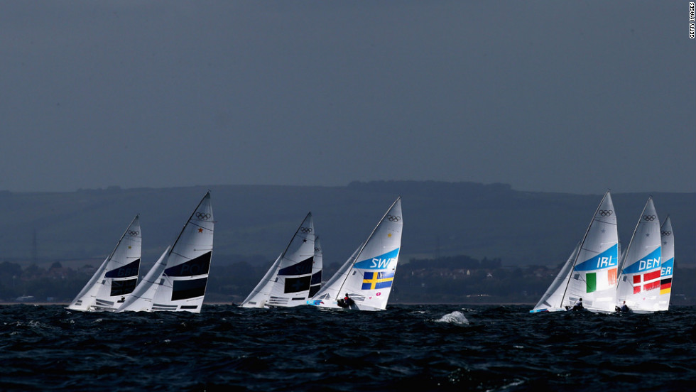 Competition gets under way in the men's Finn sailing in Weymouth, England.