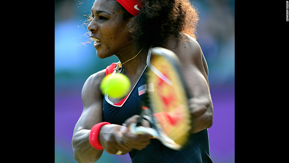 U.S. player Serena Williams makes a return against Victoria Azarenka of Belarus during their women's singles semifinal.
