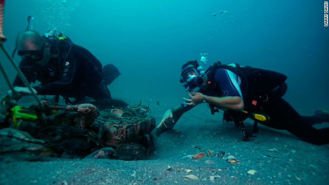 TISIRI divers and Joe Kistel inspect the wreckage of a plane on the ocean floor.