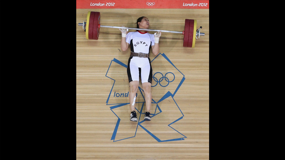 Egypt's Khalil Mahmoud K Abir Abdelrahman fails to complete a lift during the women's 75-kilogram weightlifting final.