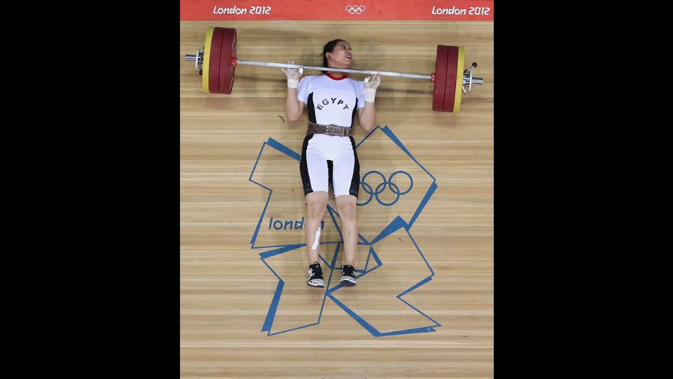 Egypt's Khalil Mahmoud K Abir Abdelrahman fails to complete a lift during the women's 75-kilogram weightlifting final.