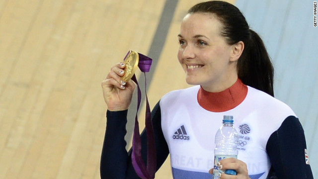 Victoria Pendleton proudly shows off the gold medal she claimed in the women's keirin.