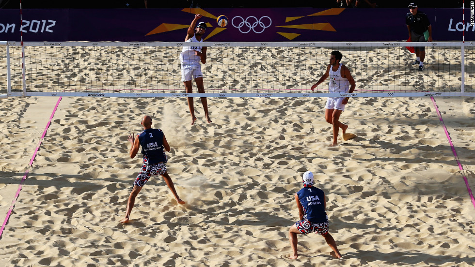 Daniele Lupo of Italy spikes the ball during the men's beach volleyball round of 16 match between the United States and Italy on Friday.