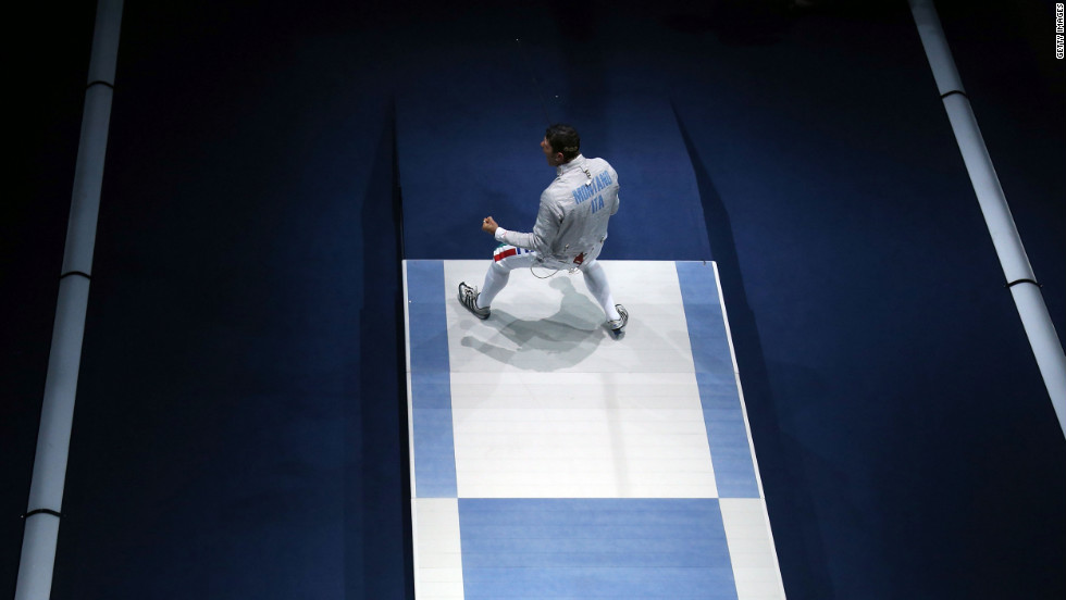 Aldo Montano of Italy reacts after winning the bronze medal by defeating Russia during the men's sabre team fencing on Friday.