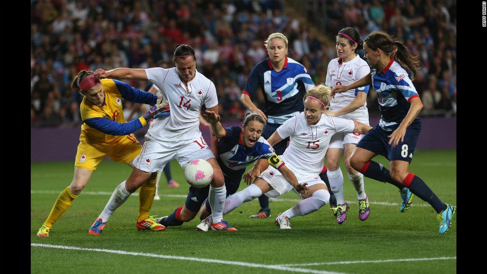 Casey Stoney of Great Britain goes down in the penalty box during the women's football quarter final match between Great Britain and Canada in Coventry, England.