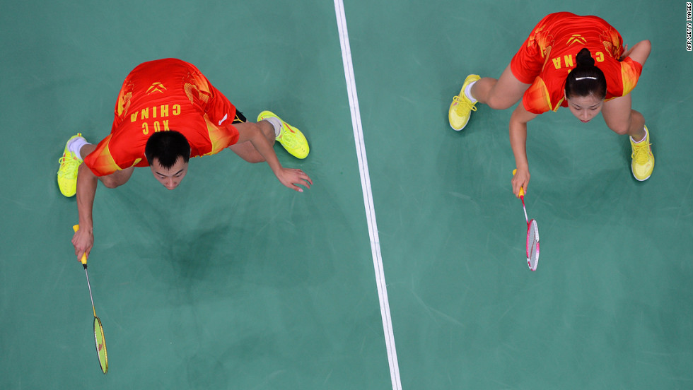 China's Xu Chen, left, and Ma Jin, right, play against China's Zhang Nan and Zhao Yunlei (not pictured) during the mixed doubles gold medal match.