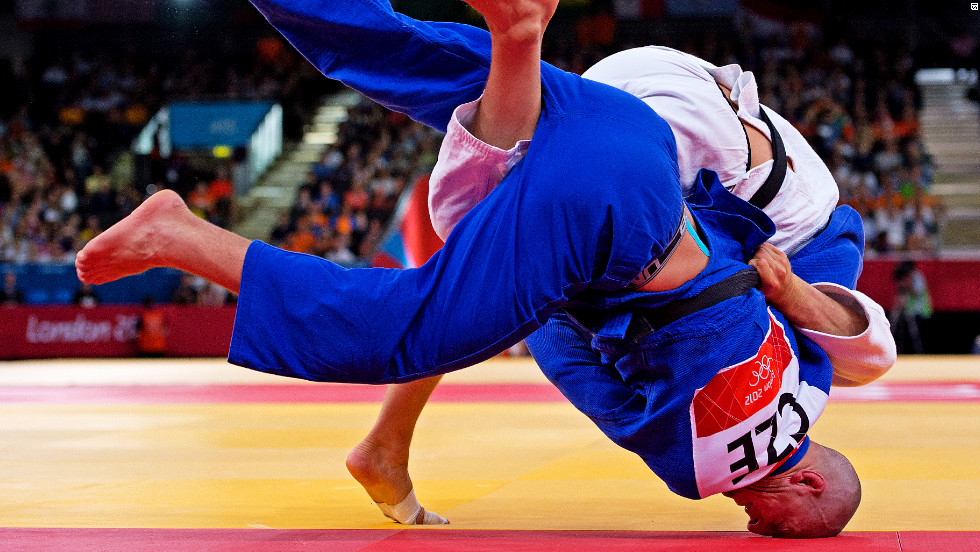 Lukas Krpalek of the Czech Republic falls to the floor during his quest fo gold in the -100kg judo competition.