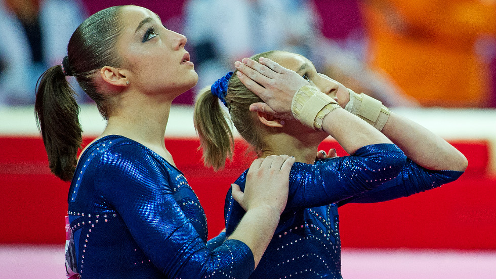Russian pair Mustafina and Victoria Komovs were forced to settle for bronze and silver respectively after Douglas dazzled the judges.