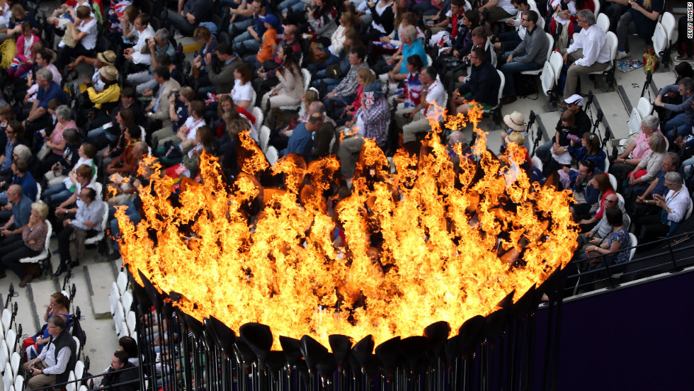 The Olympic Cauldron burns at the Olympic Stadium.